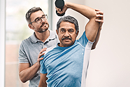 Patient and physical therapist