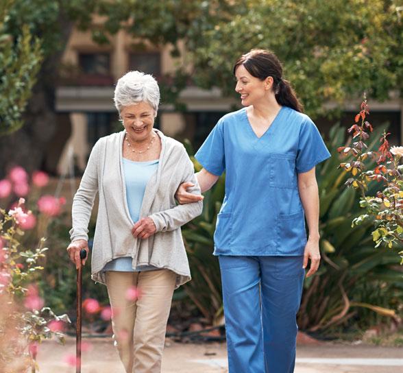 Nurse and Women Walking At Colonial Oaks